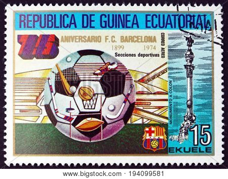 EQUATORIAL GUINEA - CIRCA 1974: a stamp printed in Equatorial Guinea shows Soccer Ball Barcelona Soccer Team 75th Anniversary circa 1974