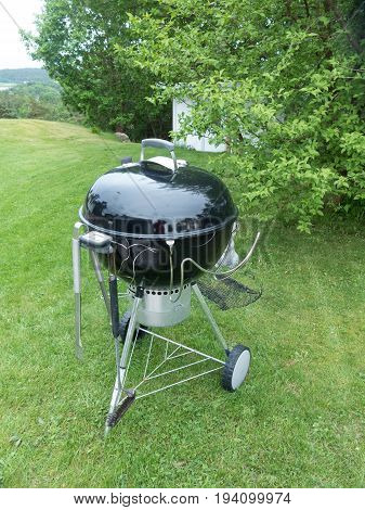 one barbeque grill in the garden ready to make the food
