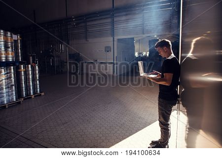 Brewery Factory Owner Using Laptop