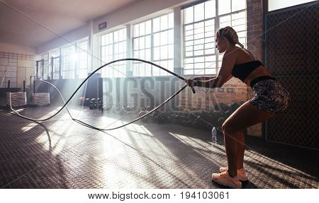 Young Woman Working Out At The Gymnasium.
