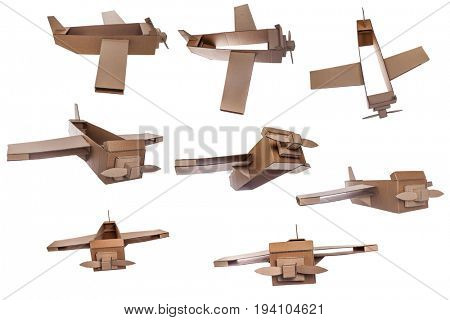 collection of cardboard airplane toy isolated on white background