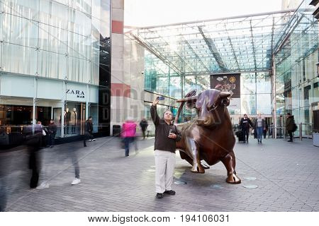 Birmingham, UK - 6 November 2016: Man Taking Selfie With Statue Outside The Bullring In Birmingham