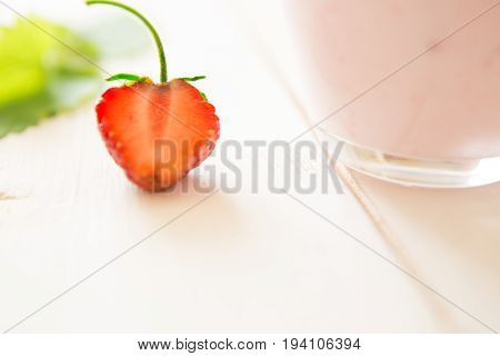 Strawberry Close-up On Rustic Wooden Table With Yoghurt