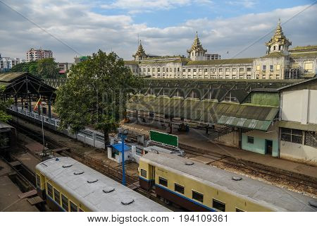 YANGON MYANMAR - DECEMBER 16 2016 : Platform and trains at Yangon Central Railway Station one of building landmarks in downtown of Yangon city.