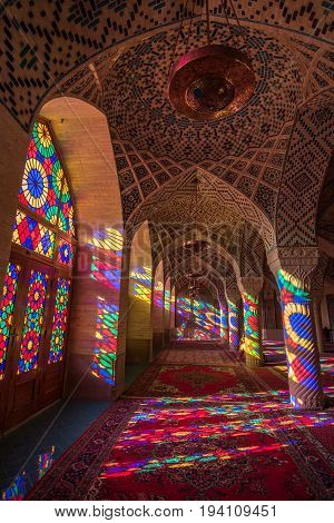 SHIRAZ IRAN - OCTOBER 23 2016 : Colorful light through stained glass window inside Nasir Al-Mulk Mosque (Pink Mosque) a traditional mosque in Shiraz Iran.