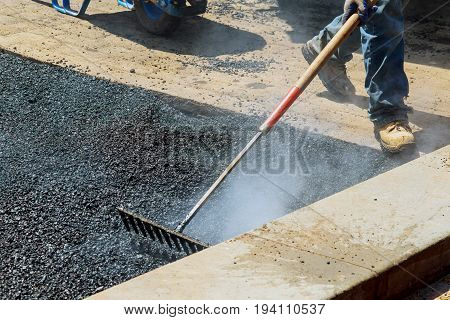 Workers On Asphalting Paver During Road Street Repairing Works.
