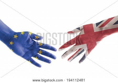 Hands painted with UK and European flags reaching out for a brexit handshake