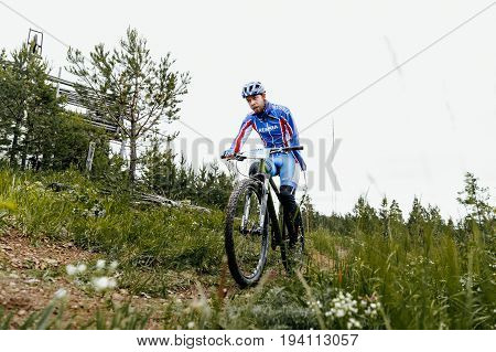 Revda Russia - July 1 2017: athlete disabled amputee no arms on bicycles during Regional competitions on mountain bike