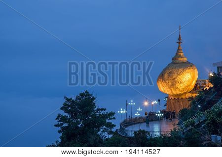 Kyaiktiyo Pagoda or Golden rock at dusk in Mon state famous destination and one of the most five holy places in Myanmar