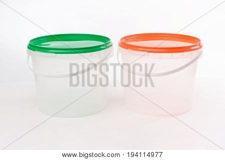 Two white plastic buckets isolated on white