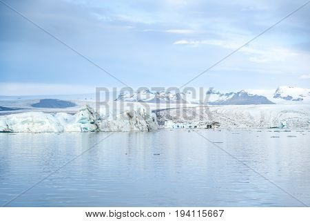 Iceberg in Jokulsarlon glacier lagoon originating from the Vatnajokull (the biggest glacier in Europe) beautiful nature landscape in winter season of Iceland