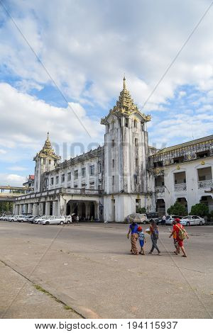 YANGON MYANMAR - DECEMBER 16 2016 : Burmese people walk to Yangon Central Railway Station one of building landmarks in downtown of Yangon city.