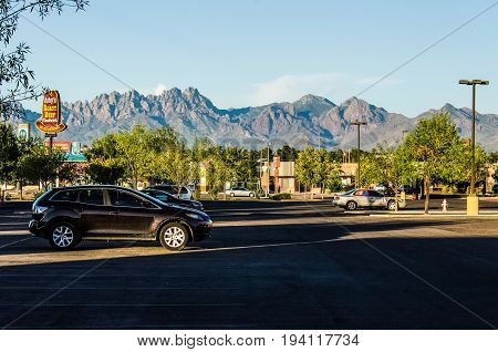 Las Cruces USA - July 26 2015: Organ Mountains in New Mexico in downtown city shopping center parking lot