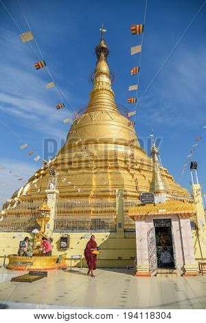 YANGON MYANMAR - DECEMBER 16 2016 : Botataung Pagoda one of famous golden pagoda near Nat Bo Bo Gyi (the name of guardian spirit) in Yangon Myanmar.