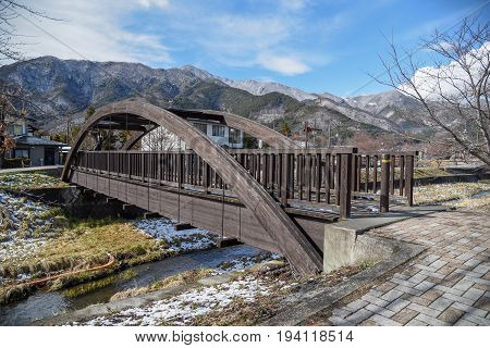 Wooden bridge across tha canal near Kawaguchi lake and Fuji mountian in late winter of Yamanashi prefecture Japan