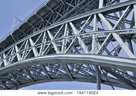 Detail arch of iron structure of Dom Luis Bridge in Porto Portugal