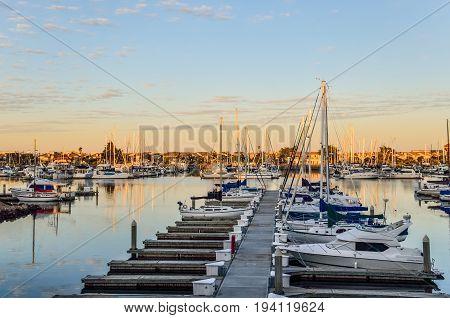 Many boats on marina during sunrise in Oxnard California