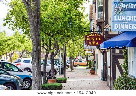 Solvang USA - March 10 2014: Restaurants and Nails and Spa stores in danish village in California in Santa Barbara County