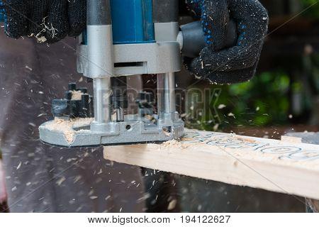 Milling-machine Wood. The Man Mills A Tree.