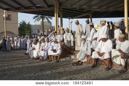 Nizwa Oman June 23rd 2017: omani people gathering at a Habta market before Eid al Fitr