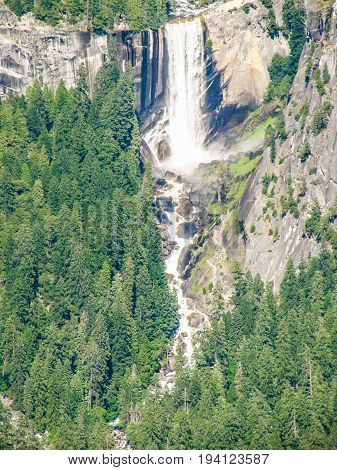 Aerial View Of Landscape During Summer In Yosemite National Park With Many Pine Trees And Falls Wate