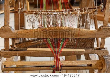 Close-up of ancient Russian traditional hand weaving loom, selective focus