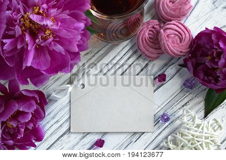Peonies Flowers Pink Glass Of Tea With Greeting Card Marshmallow On A White Wooden Background - Stoc