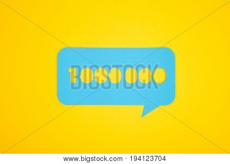 The blue cardboard bubble with the one million number on the yellow background from above.