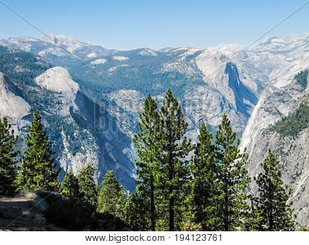 Aerial View Of Landscape During Summer In Yosemite National Park With Many Pine Trees And Mountains