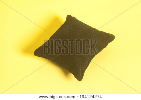 Small Black Velvet Pillow on yellow background
