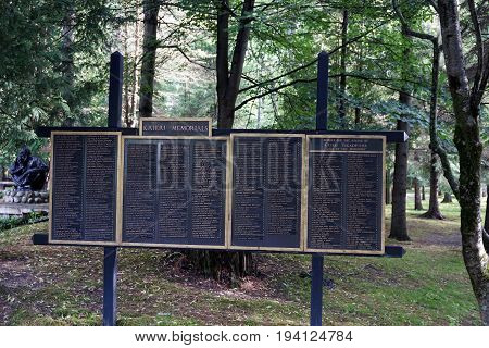 INDIAN RIVER, MICHIGAN / UNITED STATES - JUNE 18, 2017: A plaque lists the names of donors who contributed to the Kateri Memorials, and to the statue of Saint Kateri Tekakwitha, called the