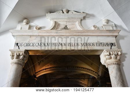 Evora, Portugal - June 12, 2017: Entrance in Chapel of Bones is one of the best known monuments in Evora. The message above entrance means: