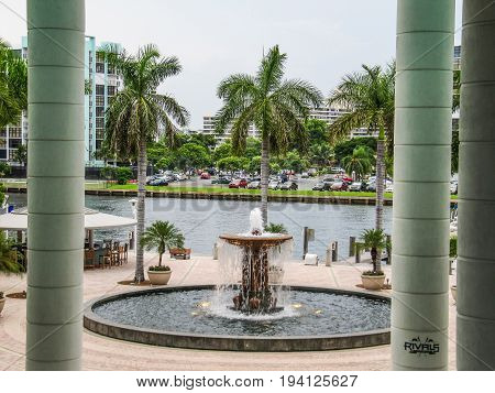 Hollywood USA - June 15 2012: Fountain and Rivals restaurant near bay by Ocean drive in Florida by Miami