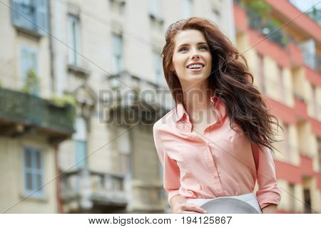 Close up Portrait, Young beautiful  woman posing outdoors in sunny weather