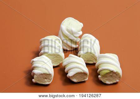Pile of marshmallows glazed . Many coated elegant zephyr dessert isolated on white. Sweet elegant dessert on a plate