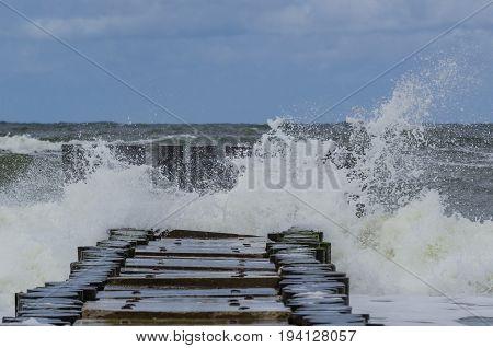 STORM - Storm waves break on the shoreline