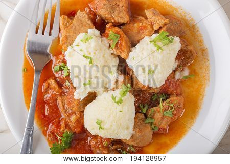 Classic goulash with dumplings delicious heavy food with dumplings