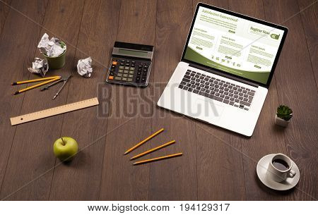 Business wooden table with notebook computer and office accessories