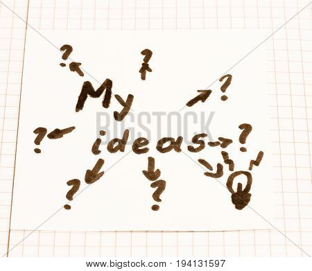 A sheet with the inscription of my ideas from which they lead arrows to question marks and only one leads to a symbolizing decision making light bulb