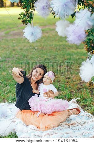 mom in the Park with my daughter taking a selfie