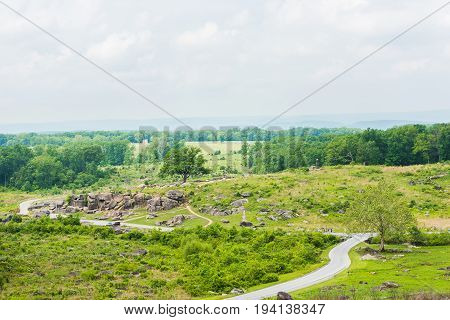 Landscape overlook view from Little Round Top in Gettysburg battlefield national park overlooking Devil's Den