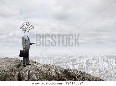 Faceless businessman with drawn brain instead of head