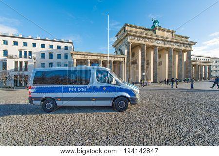 Berlin Germany - November 28 2015: Police van in front of the Brandenburg Gate