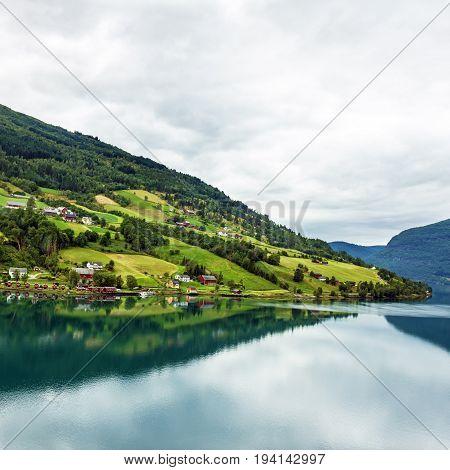 landscape, Norway, Olden green hills seaside. fjord in summer.