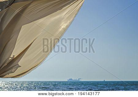Blue sky and aquamarine seas at Black Sea. Anchored are fishing boats and sailboats.