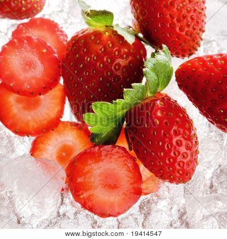 Healthy food : Strawberries with slices on crushed ice