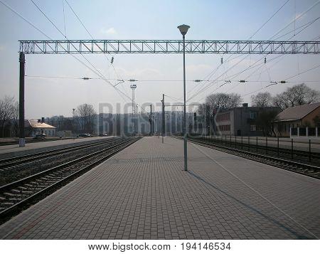 Train track railway station or platform. Empty railway station