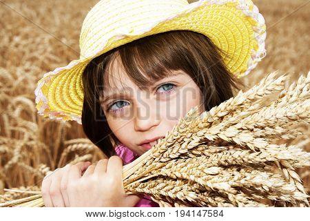 little girl portait in the wheat field