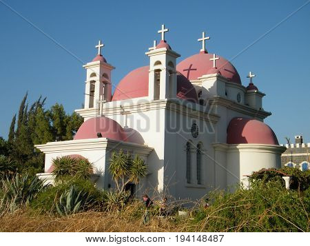 Kapernaum, Israel - October 23, 2010: View of Greek Orthodox Church of the Seven Apostles on the shores of Sea of Galilee in northern Israel.