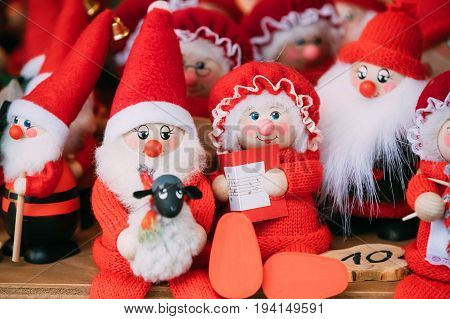 Riga, Latvia - December 2,2016: Traditional Souvenirs Santa Claus Dolls Toys At European Winter Christmas Market. New Year Wooden Souvenir From Europe.